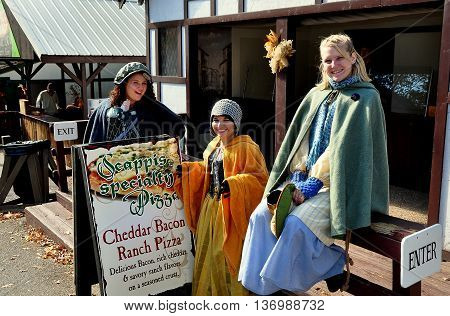 Mount Hope Pennsylvania - October 17 2015: Three women dressed in appropriate garb visiting the annual Pennsylvania Renaissance Faire