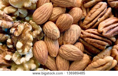 Almonds, pecans, and walnuts arranged in stripes