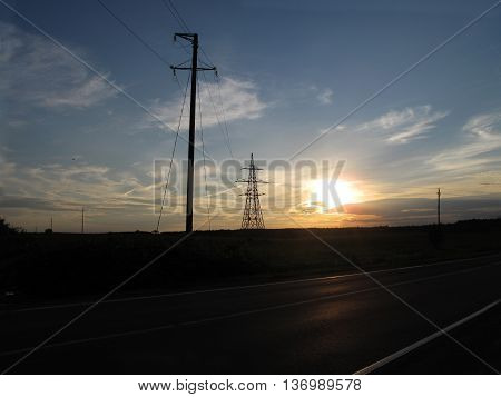 transmission towers and evening skyline the field