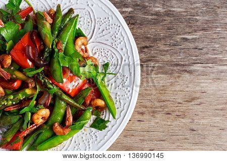 Shrimp and Asparagus stir fry food on white plate.