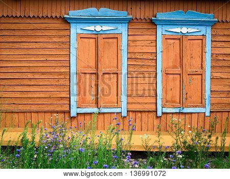Two Ornate Wooden Windows