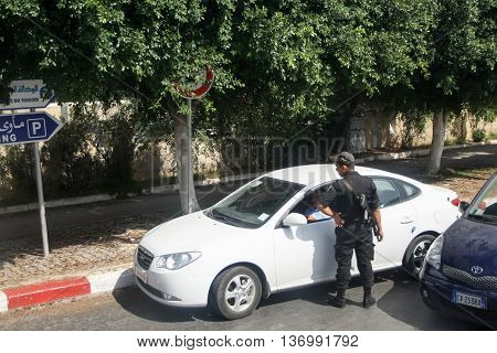Policeman Checking Driver In Tunis