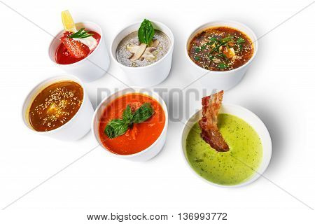 Variety of restaurant hot dishes, healthy food. Japanese miso soup, asian fish soup, russian borscht, english pea soup with bacon, mushroom soup, spanish gazpacho isolated at white.
