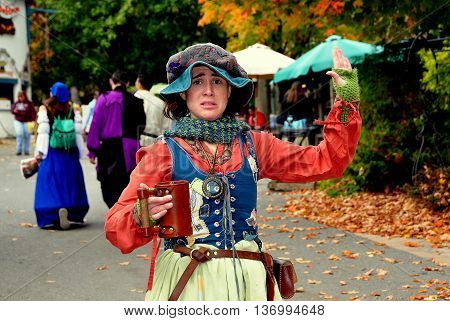 Mount Hope Pennsylvania - October 17 2015: Costumed English lass with large cup at the annual Pennsylvania Renaissance Faire