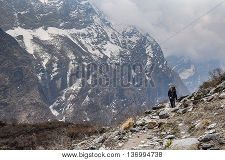 POKHARA NEPAL - APRIL 14 2016 : Woman Trekker and beautiful Himalaya mountain landscape on Annapurna Sanctaury route, Nepal.