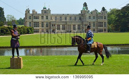 Saffron Walden, Essex, England - June 05, 2016: Two men in Elizabethan costume one on a horse in front of stately home.