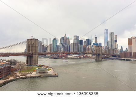 NEW YORK - CIRCA MARCH, 2016: Brooklyn Bridge in the daytime. The Brooklyn Bridge is connects the boroughs of Manhattan and Brooklyn by spanning the East River.
