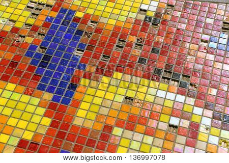 Detail of a beautiful old crumbling abstract ceramic mosaic