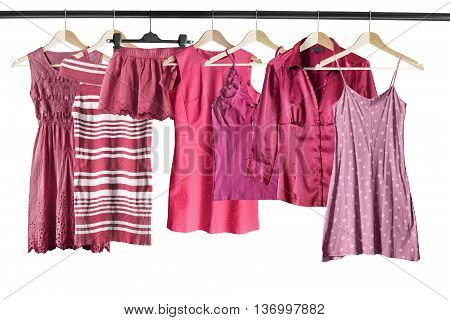 Group of pink clothes on clothes racks isolated over white