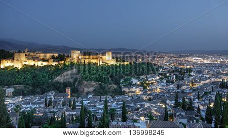 Wide angle view of Granada and the ancient arabic fortress of Alhambra at dusk. Spain.