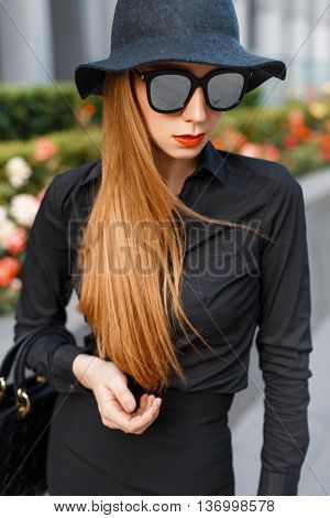 Stylish Fashionable Woman In Sunglasses, Hat And Black Shirt