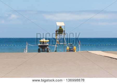 A shot of a lifeguard in a beach