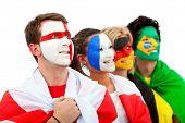 Постер, плакат: Группа футбольных болельщиков смотреть счастливы с их лица окрашены изолированные над белой