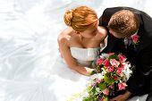 foto of bouquet  - wedding couple hugging - JPG