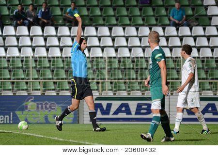 KAPOSVAR, HUNGARY - SEPTEMBER 10: Adam Nemeth (refere) in action at a Hungarian National Championship soccer game - Kaposvar (white) vs Gyor (green) on September 10, 2011 in Kaposvar, Hungary.