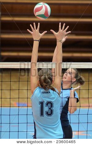 KAPOSVAR, HUNGARY - SEPTEMBER 11: Zsanett Pinter (R) in action at the Hungarian NB I. League volleyball game Kaposvar (blue) vs Budai XI. SE (light blue), September 11, 2011 in Kaposvar, Hungary.