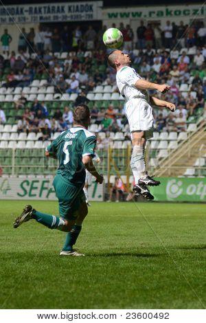 KAPOSVAR, HUNGARY - SEPTEMBER 10: Nikola Safaric (in white) in action at a Hungarian National Championship soccer game - Kaposvar (white) vs Gyor (green) on September 10, 2011 in Kaposvar, Hungary.