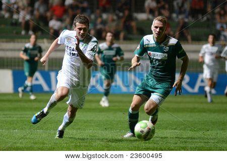 KAPOSVAR, HUNGARY - SEPTEMBER 10: Milan Peric (in white) in action at a Hungarian National Championship soccer game - Kaposvar (white) vs Gyor (green) on September 10, 2011 in Kaposvar, Hungary.