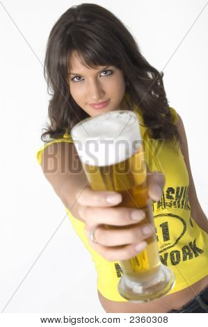 Pretty Girl Drinking Beer From The Glass