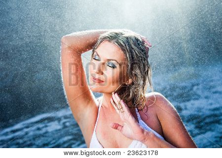 beautiful woman near river waterfalls