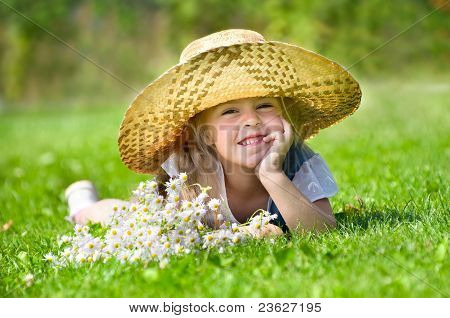 Little girl lying on the lawn