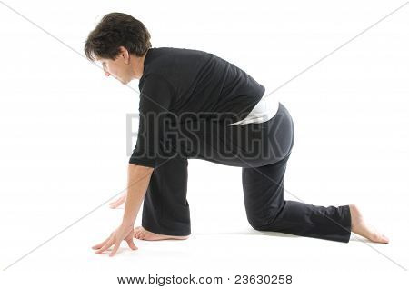 Middle Age Woman Demonstrating Yoga Position Anjaneyasana Kneeling Quadriceps Lunge & Hamstring Stre