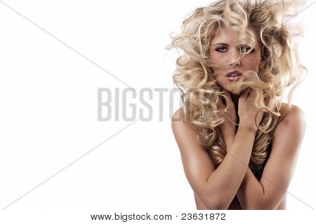 Sexy Young Woman With Hair In Wind