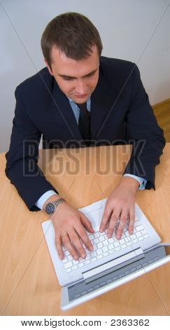 Businessman Working On White Laptop