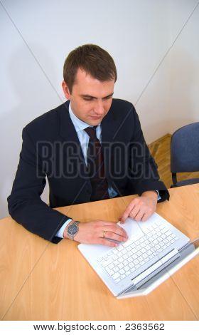 Man Working On White Laptop