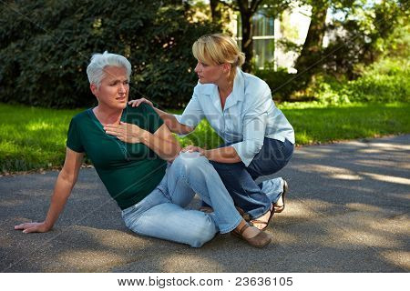 Passerby Helping Senior Woman In Park