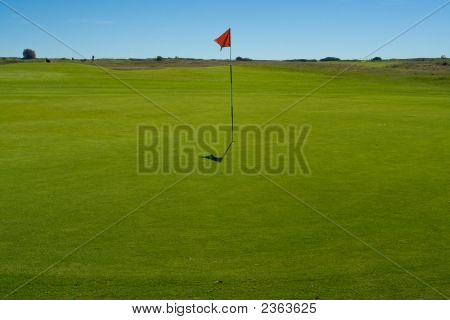 Golf Green And Flag At A Seaside Course