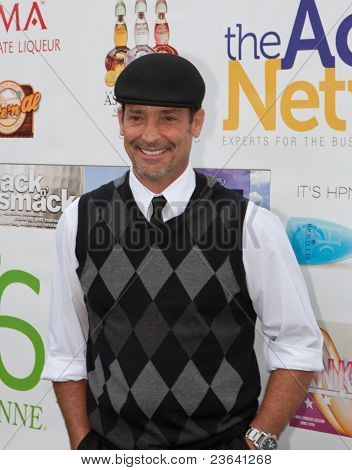 TARZANA, CA - APRIL 18: Robert Torti arrives at the 8th annual