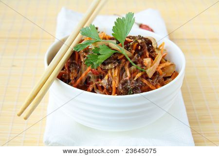 Asian style salad with carrots, meat and chili peppers