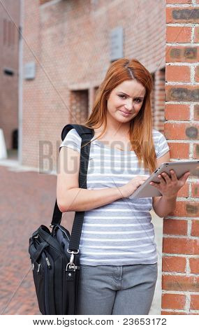 Portrait Of A Young Student Working With A Tablet Computer