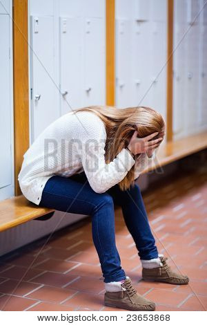 Portrait Of A Depressed Student Sitting On A Bench