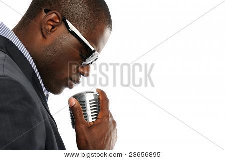 Young African American Man with vintage microphone isolated on a white background