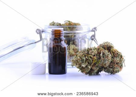 poster of Medicinal Marijuana Cannabis With Extract Oil In A Bottle. Cannabis Cbd Oil Hemp Products. Cannabis