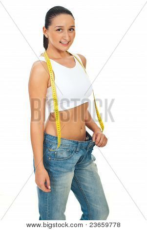 Slim Young Woman In Big Jeans