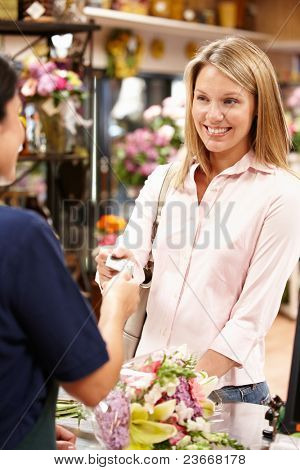 Women being served at florist