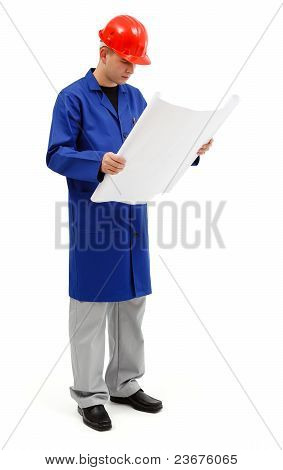 Young Engineer Looking At Project Plans