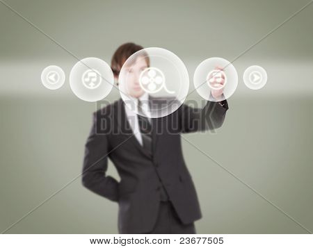 Businessman touching screen with buttons on it