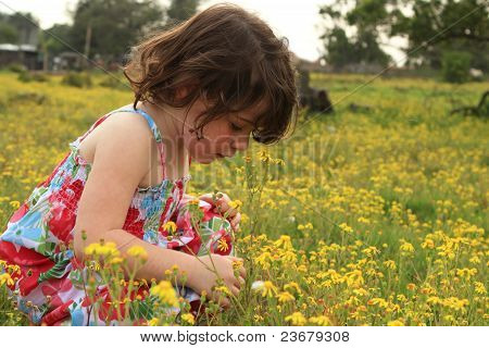Young Girl Walking Through A Meadow