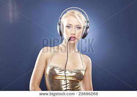 Blonde Model In Gold Swimwear