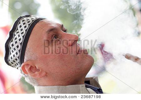 Man In Tubeteika Smoking Shisha