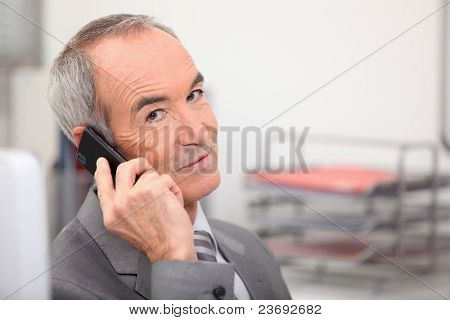 Admin worker with mobile telephone