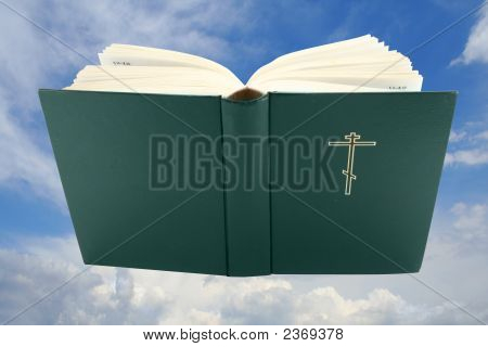 Opened Bible Book Over Sky With Clipping Path