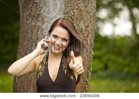 smiling woman posing thumbs up