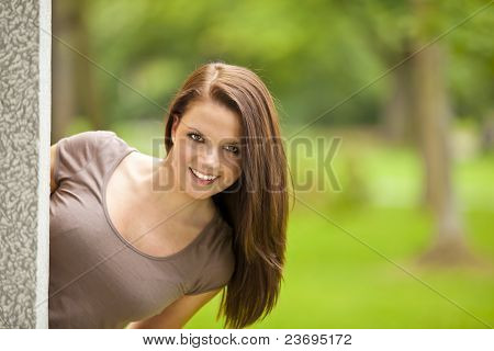 smiling woman posing in park
