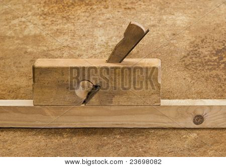 Planer On Wood In Brown Background