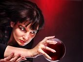 stock photo of witch ball  - Young woman  with crystal ball - JPG